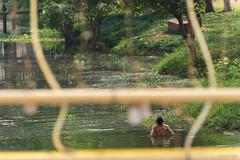 River dip (Jonathan Stening) Tags: people man water swimming river nikon cambodia bathing fx siemreap jonathanstening