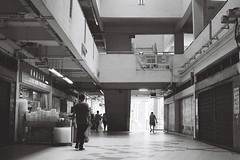 Empty (OzGFK) Tags: street people blackandwhite film monochrome analog mall shopping nikon singapore asia streetphotography stall shops nikkor hdb rochor rochorcentre rochorcomplex