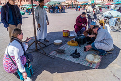 snakes, tourists, cigarettes (tattie62) Tags: travel people tourism places morocco marrakech snakes djemaaelfna