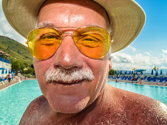 """Fear and Loathing"" (Vittorio.DellErba) Tags: blue light boy red summer portrait sky orange sun white mountain color men water pool face look hat yellow clouds person glasses nikon shadows floor outdoor horizon first whiskers"