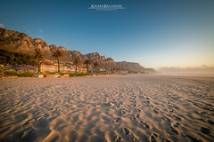 Camps Bay (Chiara Salvadori) Tags: ocean africa travel winter light sunset sea sun seascape beach water colors southafrica spring sundown outdoor capetown atlantic traveling tablemountain campsbay capepeninsula sudafrica