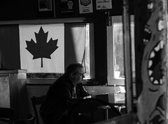 Waiting in the shadow (Howard Yang Photography) Tags: toronto canada restaurant candid streetphotography canadian canadianflag kensingtonmarket xf56mm fujifilmxpro2