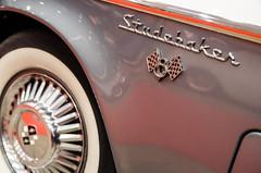 Studebaker V8 (GmanViz) Tags: color detail car wheel nikon automobile tire fender chrome badge type 1957 studebaker script whitewall silverhawk gmanviz d7000 pistonpowershow