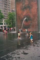 92590019 (kodak retina II c) Tags: chicago kids children illinois downtown sprinkler waterplay