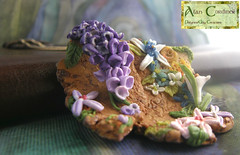 'Flower Garden Polymer Clay Pendant. (Polymer Clay Delights) Tags: woodland diy moss handmade unique oneofakind ooak polymerclay fungus handcrafted lichen wildflowers callalily wisteria enchantedforest flowergarden enchantedwood fairygarden handsculpted polymerclayjewellery polymerclaypendant polymerclaynecklace naturenecklace naturejewellery flowerjewellery
