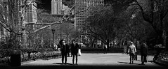 It's A Bird, It's a Plane .... (Professor Bop) Tags: park city nyc newyorkcity trees people urban blackandwhite bw monochrome buildings structures benches madisonsquarepark drjazz professorbop olympusem1