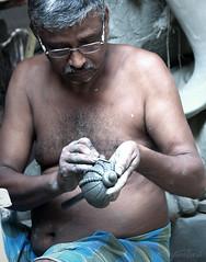 An artisan in Kumartuli, Kolkata (me suprakash) Tags: people artist menatwork making kolkata artisan westbengal nikon18200mm concentartion kumartuli nikond90 kumartulipatuapara