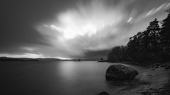 Cloudsplosion (jarnasen) Tags: longexposure sky blackandwhite bw copyright lake storm nature monochrome rock clouds landscape island mono nikon afternoon sweden outdoor tripod smooth lakeside explore le april rainstorm sverige nikkor raining beack hailstorm svartvit stergtland movingclouds ndfilter explored d810 jrnlunden hackelbo rimforsa leefilters nd10 nordiclandscape bigstopper 1635mmf4 jarnasen flsklsen