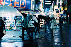 112/366 : Rainy Night in Shinjuku (hidesax) Tags: street leica light wet rain sign japan umbrella lights tokyo store shinjuku neon x plastic passersby vario 365project 366project 112366 hidesax rainynightinshinjuku 366project2016