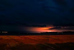 Lampi sul gigante (spillo46) Tags: sardegna panorama store nuvole cielo luci gigante notte paesaggio lido alghero tempesta lampi alguer fulmini capocaccia