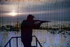 30-302 (ndpa / s. lundeen, archivist) Tags: winter sky people sun snow man color fall film ice 30 alaska clouds 35mm coast town mine gun village horizon nick rifle hunting mining spots coastal weapon 1970s damaged 1972 distressed targetpractice unidentified alaskan dewolf discolored heatdamage miningcamp damagednegative nickdewolf photographbynickdewolf coastalvillage reel30