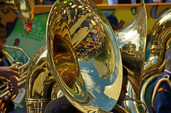 Mardi Gras captured in the bell of a tuba (Monceau) Tags: people reflection buildings colorful bell parade mardigras tuba kreweofiris paradestands