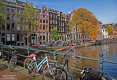 Bikes and Canal Houses on the Singel in Amsterdam (PhotosToArtByMike) Tags: holland netherlands dutch amsterdam boats bikes singel canalhouse singelcanal grachtengordel canalring