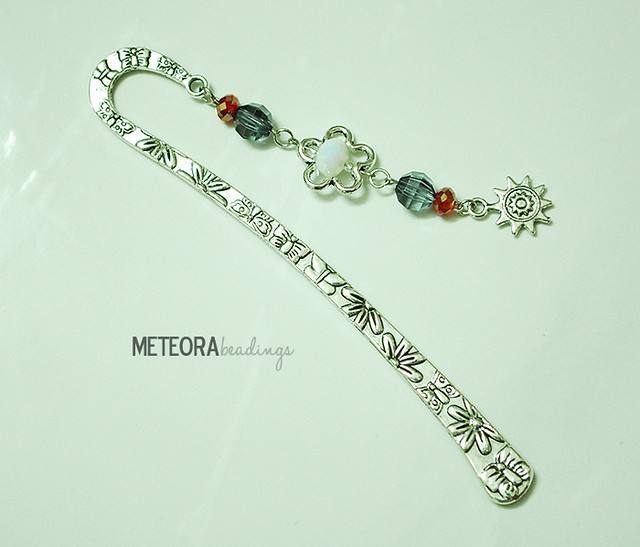 Bookmark - light black, red and white beads, with silver flower and sun charm