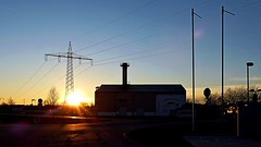 Urban Sunset (Erich Hochstger) Tags: light sunset urban sun backlight austria licht sterreich sonnenuntergang outdoor powerline powerplant kraftwerk powerpole sonne niedersterreich gegenlicht amstetten strommast stromleitung loweraustria heatingplant heizwerk