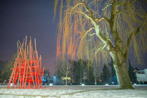 A red playground at night