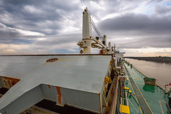 Bow to Stern (Tom Pumphret) Tags: ocean sea usa water canon river outdoors photography la boat industrial ship no ships neworleans transport grain vessel cargo anchorage commercial maritime bow transportation mississippiriver nautical shipping import carrier navigation logistics export bulk bulkcarrier seafaring lousisiana bulker commercialship trampship