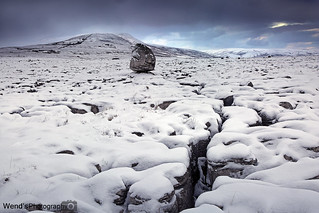[Explored] Twistleton scar in the snow with Ingleborough in the distance, Yorkshire Dales National Park, England. UK