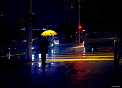 The yellow umbrella (Ren Mollet) Tags: street morning woman colour rain yellow night umbrella nightshot earlymorning streetphotography pedestrian basel rainy strip 35 regen renmollet