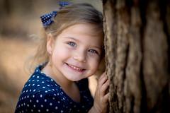 Reese (Mark Wingfield) Tags: blue trees portrait girl children outside outdoors eyes nikon natural 14 85mm handheld polkadot d610