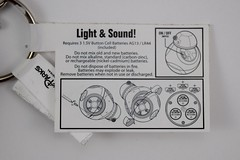 Disneyland Purchases - 2016-03-06 - BB-8 Light-up Keychain - Lying Down - Closeup View of Instructions Tag (drj1828) Tags: starwars keychain disneyland lightup purchase droid 2016 bb8 theforceawakens