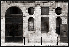Barred (albireo 2006) Tags: door windows blackandwhite bw window blackwhite bars malta pb nb bn barred blackandwhitephotos blackwhitephotos