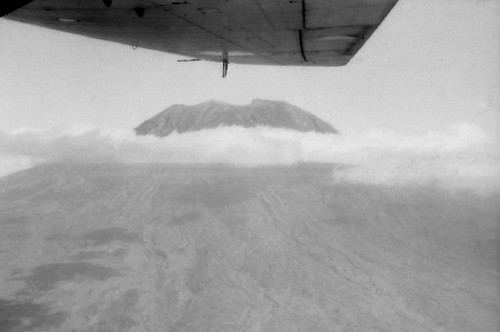 1970 RNZAF Bristol Freighter NZ5906 passing Mt Rinjani, Lombok, Indonesia returning from Bersatu Padu.