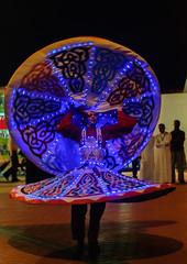 Twirling Darwish (daarkfire) Tags: dance dubai performance darwish global twirling vlilage