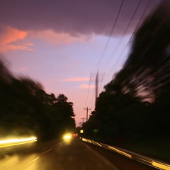 "the long way home (listening to ""soft shoulder"", ani difranco) (jeneksmith) Tags: road street longexposure pink blue summer sky storm black wet rain yellow night canon lights drive evening purple july powerlines heat thunderstorm bluehour gloaming canoneos70d"