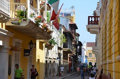 Cartagena, Colombia Street Scene (Corvair Owner) Tags: street door plaza old city flower color building beach buildings scenery colorful colombia balcony centro january statues columbia balconies scenes cartagena cartegena oldcity walled 2016 historico