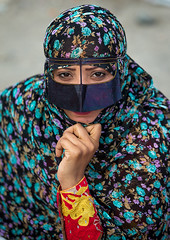 a bandari woman wearing a traditional mask called the burqa at panjshambe bazar thursday market, Hormozgan, Minab, Iran (Eric Lafforgue) Tags: portrait people woman face vertical outdoors persian clothing asia veil mask iran market muslim islam religion hijab culture persia headshot hidden covered iranian bazaar adults adultsonly oneperson islamic traditionaldress burqa customs ethnicity middleeastern frontview sunni burka chador 20sadult youngadultwoman balouch hormozgan onewomanonly lookingatcamera burqua  bandari  1people  iro thursdaymarket  minab colourpicture  borqe panjshambe panjshambebazar boregheh iran034i2899
