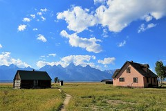Path to the Past (Patricia Henschen) Tags: pink house mountains clouds cabin path trail wyoming grandtetons outhouse tetons pinkhouse grandtetonnationalpark privy mormonrow pathscaminhos