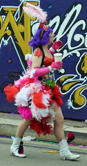 Dressed in red and white feathers, purple hair - Krewe of Tucks parade (Monceau) Tags: red white hair walking women colorful purple neworleans feathers parade mardigras beadwork streetnames kreweoftucks damesdeperlage