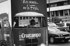 (giovanibr) Tags: street people urban espaa playing bus girl drive sevilla andaluca spain espanha child play candid abril streetphotography feria feira hidden behind cruzcampo sevilha andaluzia seviile