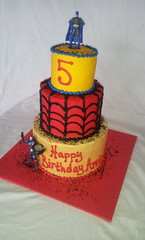 Superhero Birthday Cake (tasteoflovebakery) Tags: birthday blue red man black yellow cake kid iron cartoon spiderman superhero batman