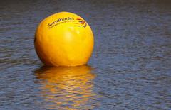 Yellow (Reinardina) Tags: reflection water yellow ball advertising advertisement ripples sandbanks buoy lakesidecountrypark
