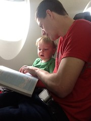 "Paul and Daddy Read the In-Flight Magazine on Paul's First Plane Ride • <a style=""font-size:0.8em;"" href=""http://www.flickr.com/photos/109120354@N07/25957401042/"" target=""_blank"">View on Flickr</a>"