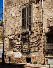 Balcony with shadows (Tiigra) Tags: door city travel shadow window valencia wall architecture fence spain ruin es lattice valncia 2015 comunidadvalenciana