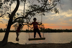 Swinging on the Sunset (fredMin) Tags: travel sunset river children kid cambodia fuji swing fujifilm fujinon kampot xt1