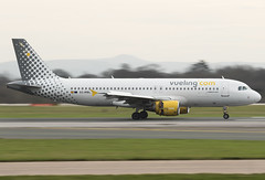 Vueling EC-MBL 28-12-2015 (Enda Burke Photography) Tags: travel england holiday man window plane canon airplane t manchester evening fly flying airport wings holidays aviation flight wing engine apron landing motionblur engines planes airbus pan arrival panning terminal3 departure takeoff runway pilot flightdeck avp aero manchestercity pennines a320 manchesterairport winglets taxiing terminal2 terminal1 rvp manc taxiway airbusa320 egcc av8 vueling aviationviewingpark avgeek manairport landingear runwayvisitorpark runwayvistitorpark t3carpark manchesterrunwayvisitorpark ecmbl canon7dmk2