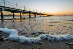 Sunset-DSC03878-120116 (Igor Vlah) Tags: sunset sea sky sun beach pier waves stones sony slovenia 12mm portoroz samyang a6000