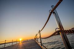 Sunset-DSC03865-120116 (Igor Vlah) Tags: sunset sea sky sun beach pier waves stones sony slovenia 12mm portoroz samyang a6000