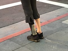 Standing at the Curb on Castro (Lynn Friedman) Tags: sanfrancisco fashion shoes leg curb brace 94114 lynnfriedman