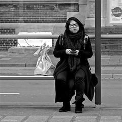 Texting with closed eyes... (Akbar Simonse) Tags: street woman holland netherlands bench square glasses candid nederland streetphotography cellphone bank denhaag smartphone plasticbag mobilephone das shawl haag spectacles thehague bril peple tramstop mobieltje vierkant tramhalte lahaye sgravenhage agga straatfotografie dscn0685 plastictasje akbarsimonse geldopjeovchipkaartzetten
