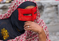 a bandari woman wearing a traditional mask called the burqa at panjshambe bazar thursday market, Hormozgan, Minab, Iran (Eric Lafforgue) Tags: red people woman face horizontal outdoors persian clothing asia veil mask iran market muslim islam religion hijab culture persia headshot hidden covered iranian bazaar adults adultsonly oneperson islamic traditionaldress burqa customs ethnicity middleeastern sunni burka chador balouch hormozgan onewomanonly burqua  bandari  embroidering 1people  iro thursdaymarket  minab unrecognizableperson colourpicture  borqe panjshambe panjshambebazar boregheh iran034i2835