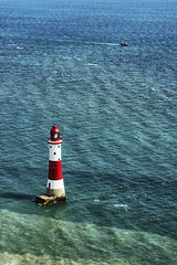 Beachy Head Lighthouse (Twin Group) Tags: uk sea england lighthouse color tower vertical architecture vintage outdoors photography sussex europe day unitedkingdom sunny nopeople landmark eastbourne copyspace fishingboat picturesque eastsussex edwardian englishchannel beachyhead nationallandmark