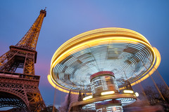 UFO near Eiffel Tower (.mushi_king) Tags: city light motion blur paris france tower night europe long exposure fairground dusk eiffeltower carousel fair eiffel trail toureiffel