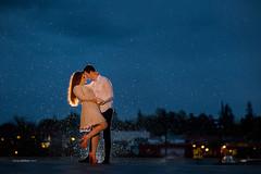 Romance in the rain. (www.sergeybidun.com) Tags: city boy sky people woman man love wet girl rain weather backlight night clouds couple romance sergey sergeybidun