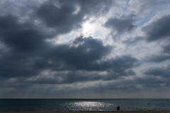 Sun rays from The Cloud (eltonmaxim) Tags: light sea cloud sunlight beach sunshine sunrise landscape natural atmosphere sunrays cloudscape sunbeams crepuscularrays illuminate lightrays godrays
