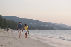 Sunset Stroll Along Bang Tao (tylerkingphotography) Tags: ocean travel sunset sky woman man beach water walking lens landscape thailand photography sand nikon couple southeastasia photographer outdoor perspective kingdom explore backpacking thai kit 1855mm traveling phuket amateur lagunabeach andamansea beachscape bangtaobeach thalang d3100